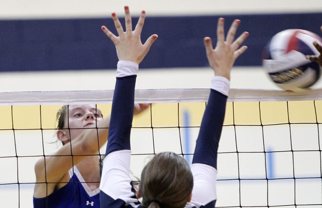 Webster Schroeder's Ally Smith, left, sends a shot past Sutherland's Taylor Kells during girls volleyball action between the Pittsford Sutherland Knights and the Webster Schroeder Warriors in Pittsford on Wednesday, Sept. 11, 2013. Sutherland won in four games.