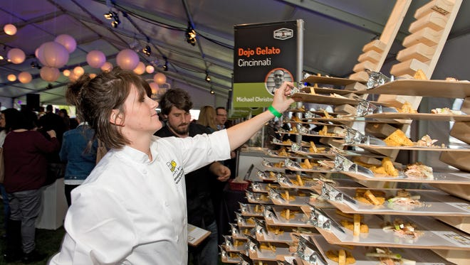 Frances Kroner of Northside sets out sample trays for the Sleepy Bee at the 2014 Cincinnati Food + Wine Classic.