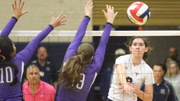 Monica Roberts, right, of Coronado spikes the ball
