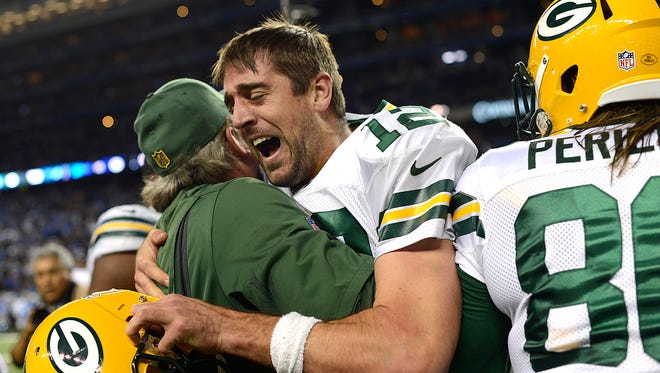 Green Bay Packers quarterback Aaron Rodgers reacts after throwing a Hail Mary to win the game against the Detroit Lions  at Ford Field in Detroit.