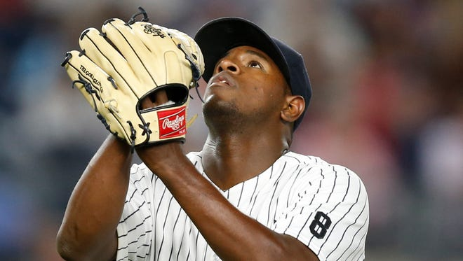 New York Yankees' Luis Severino reacts coming off the mound after the top of the seventh inning of the Yankees' 9-5 victory over the New York Mets in a baseball game, Wednesday, Aug. 3, 2016, in New York.