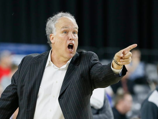 Southern Miss basketball coach Doc Sadler calls a play