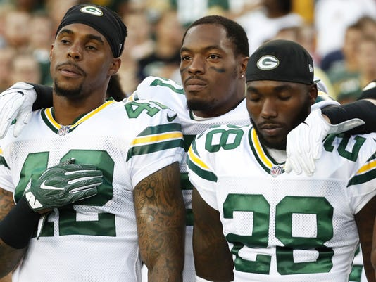 Green Bay Packers free safety Ha Ha Clinton-Dix (21) puts his arms around teammates strong safety Morgan Burnett (42) and cornerback Josh Hawkins (28) during the playing of the National Anthem before an NFL preseason football game against the Washington Redskins in Landover, Md., Saturday, Aug. 19, 2017. (AP Photo/Alex Brandon)