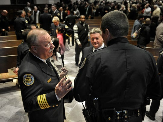 Metro police Chief Steve Anderson talks with commanders at the Session 76 police graduation at Granny White Church of Christ on Dec. 18, 2014, in Nashville.