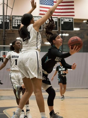 Mya Giusto of Gulf Coast puts up a shot against Ursuline Academy during the National Division championship game of the Naples Holiday Shootout tournament at Gulf Coast High School on Saturday, Dec. 30, 2017.