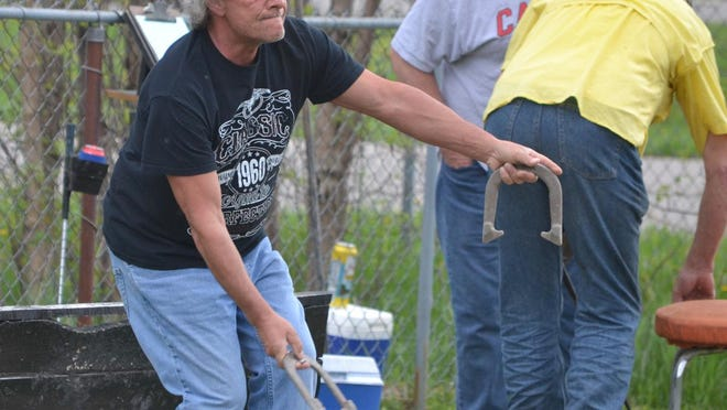 Jim Preseau throws a horseshoe during a Cheboygan Horseshoe League game.