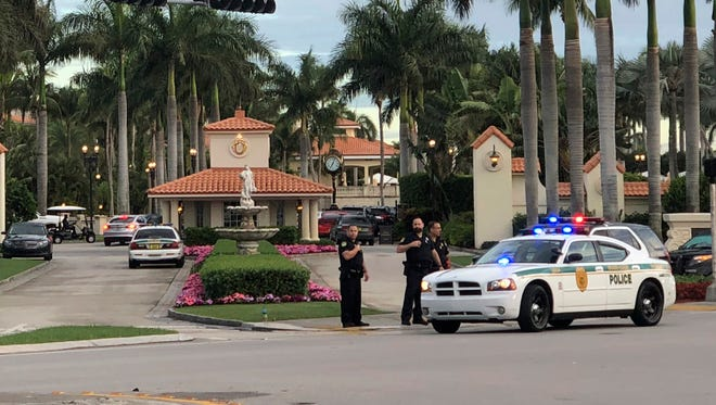 Police respond to The Trump National Doral Golf Club after reports of a shooting inside the resort May 18, 2018 in Doral, Fla.  A man shouting about President Trump, who wasn't at the club, entered the president's south Florida golf course early Friday, draped a flag over a lobby counter and exchanged fire with police before being arrested, police said.