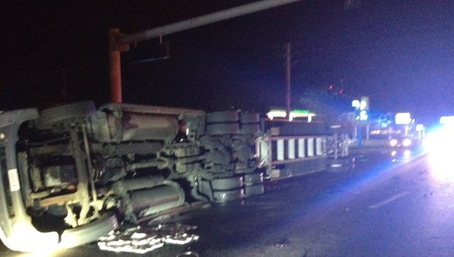 A semi truck overturned on SR 520 near Cocoa, spilling diesel fuel