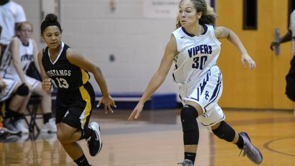 Adrianna Knight of Space Coast (30) is pursued downcourt by Breonna May of Merritt Island during their game Wednesday.