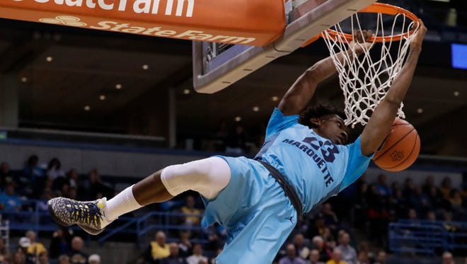 Marquette's Jajuan Johnson dunks during the first half.