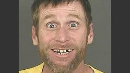 A photo provided by the Denver District Attorney's Office shows Michael Whitington with a broad, toothy smile and eyes open wide after his Sept. 23, 2014, arrest in Denver.