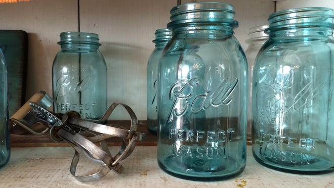 Brides go to Water Street Vintage to find Ball jars and tea cups for vintage-theme weddings.  The jars are used for candles or vases.