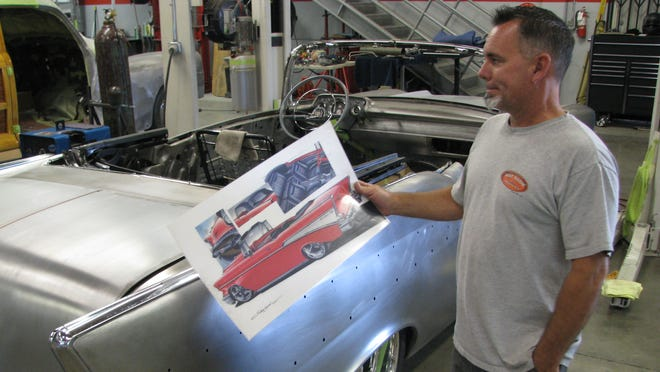 Scott Bonowski, owner of Hot Rods and Hobbies in Signal Hills, Calif., shows a drawing of what a 1957 Chevrolet Bel Air will look like when he is done restoring it.