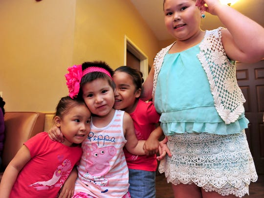 Jayda WhiteClay, second from left, hangs out her family at the La Quinta Inn and Suites in Great Falls on Monday evening as she prepares for her week long Make-A-Wish trip to Disney World.  Jayda, age 4, is in cancer remission and hopes to see Mickey and Minnie Mouse on her trip.