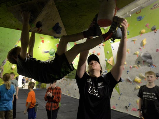 Larissa Donahue, coach for the Hi-Line Climbing Team, gives instruction during Thursday evening's practice at Hi-Line Climbing Center.