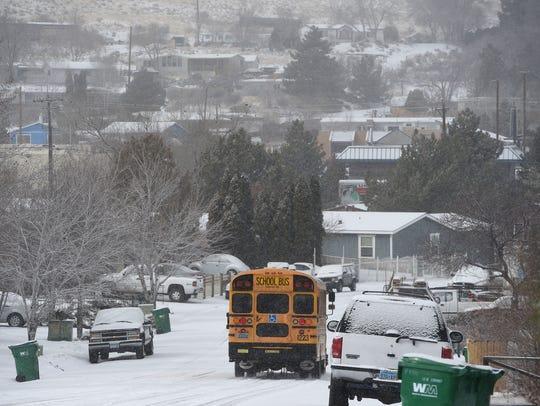A WCSD bus drives through Sun Valley picking up kids
