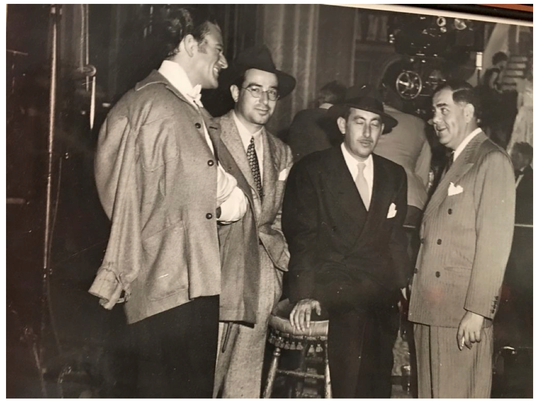 """Louise's father Albert J. Cohen second from left, with John Wayne next to him. Cohen produced Wayne's 1944 film """"The Fighting Seabees"""""""