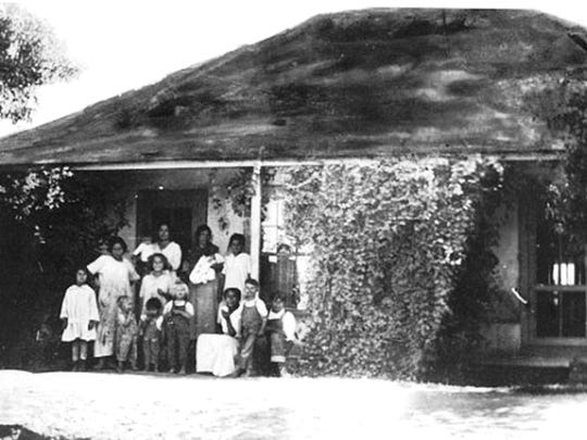"""The Elias-Rodriguez House, depicted in a circa 1920 photograph with the Elias family, is now a city-owned House Museum. The small 4-room dwelling will be the site for an innovative, interactive theatrical production """"La Casa de Inez."""""""