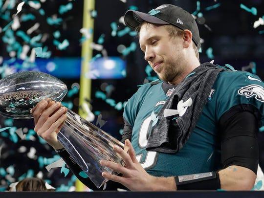 Philadelphia Eagles' Nick Foles holds up the Vince
