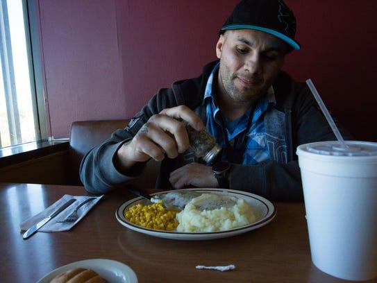 Jonathan Nevarez, a regular at Abraham's Cafe on the