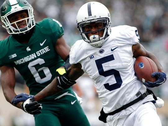 Penn State receiver DaeSean Hamilton (5) gets away from Michigan State safety David Dowell (6) for a 31-yard touchdown during the first half of an NCAA college football game, Saturday, Nov. 4, 2017, in East Lansing, Mich. (AP Photo/Al Goldis)