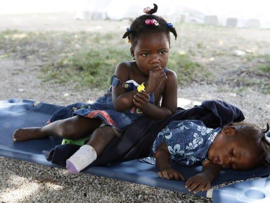 636514322052248771-Shakira-2010-Haiti.jpg