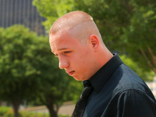 "Shane Gaskill, 19, of Wichita, Kan., leaves the federal court in Wichita, Wednesday, June 13, 2018. Gaskill and Casey Viner, 18, of North College Hill, Ohio, online gamers whose alleged dispute over a $1.50 Call of Duty WWII video game bet ultimately led police to fatally shoot a Kansas man, pleaded not guilty Wednesday to charges related to the ""swatting"" case that drew national attention."