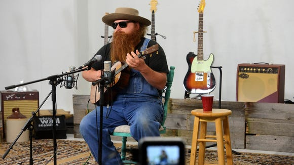 Folk singer Willy Tea Taylor warms up before a recording session for the White Wall Sessions in Sioux Falls.