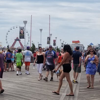 The Boardwalk in Ocean City is busy Sunday as visitors