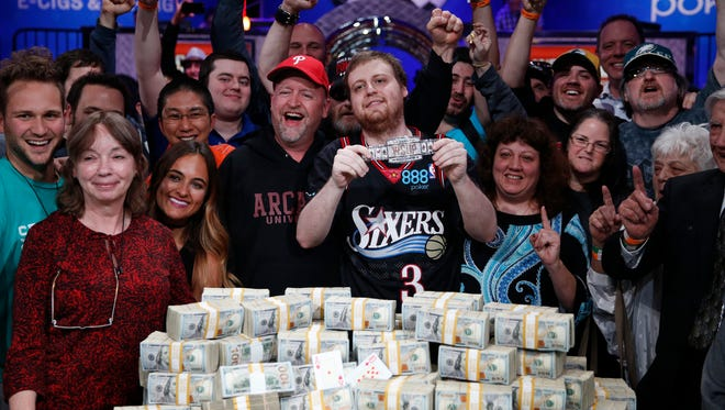 Joseph McKeehen poses with friends and family after winning the Main Event at the World Series of Poker on Tuesday, Nov. 10, 2015, in Las Vegas. McKeehen won more than $7 million.