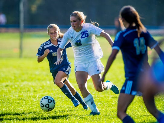 Colchester's Amber Sicard, right, brings the ball down