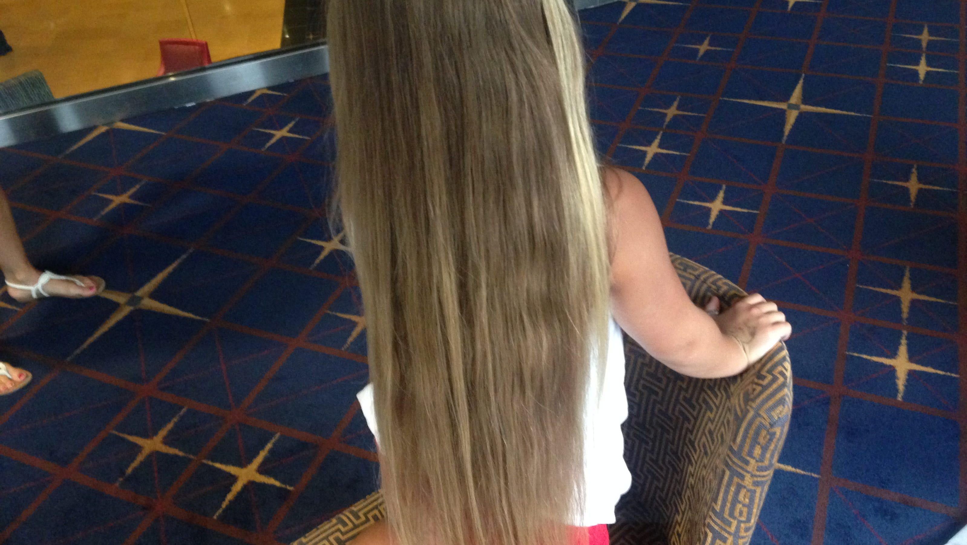 Family drives from Louisiana to donate to Wigs for Kids