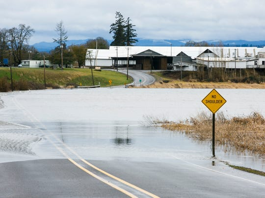 Hazelgreen Road NE near Torvend Road, just west of Silverton, was closed as Pudding River reached high water levels on Thursday, Feb. 9, 2017. A flood watch for the Willamette Valley remains in effect through Saturday morning.