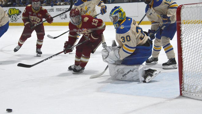 Lake Superior State competes against Denver in a game last season at Taffy Abel Arena. The Lakers have been picked to finish 6th in the WCHA in the preseason media poll.