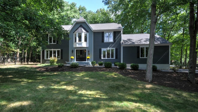 This just-listed home has a gourmet kitchen, a first-floor bedroom, four bedrooms on the second floor and more than half an acre of land in Morris Township.
