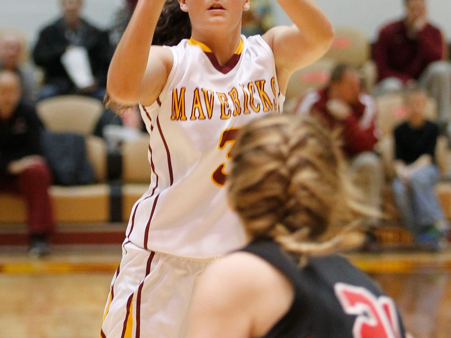 McCutcheon's Gabby Gary with a shot from the top of the arc against Lafayette Jeff in girls sectional basketball action Friday, February 13, 2015, at McCutcheon High School. McCutcheon defeated Lafayette Jeff 43-33.