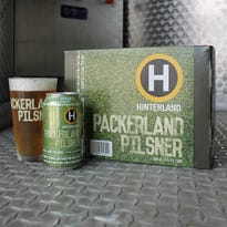 Hinterland Brewing's Packerland Pilsner is now available in 12 packs of 12-ounce cans.