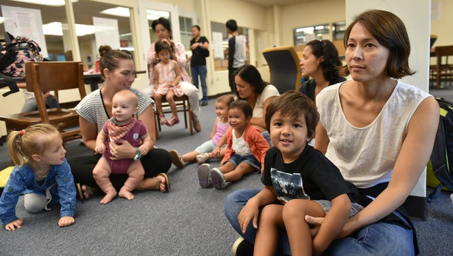 Parents participate in activities with their children while attending a toddler program at the Nieves M. Flores Memorial Library in Hagåtña on May 31, 2017.