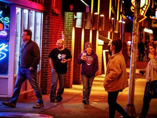 """Before a recent Grizzlies game, patrons of Beale Street enjoy a """"large beer"""" as they walk up down the three block area that the City allows open containers of alcohol. Next week, the Memphis City Council could vote to extend the open containers ordnance to include a larger area of Downtown, stretching from the Mississippi River to Danny Thomas Boulevard."""