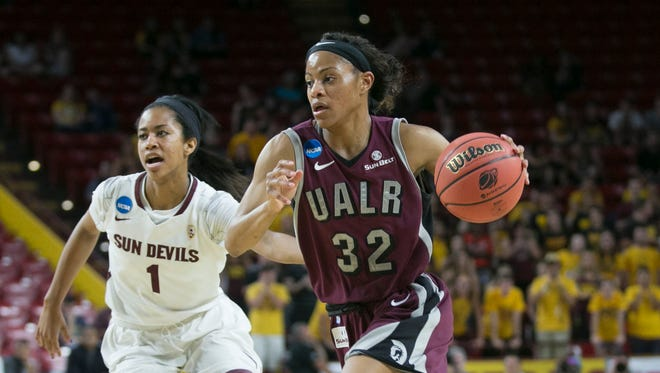UALR's Ka'Nesheia Cobbins (32) drives to the hoop against ASU's Arnica Hawkins (1) in the first half at Wells Fargo Arena in Tempe, AZ on March 23, 2015.