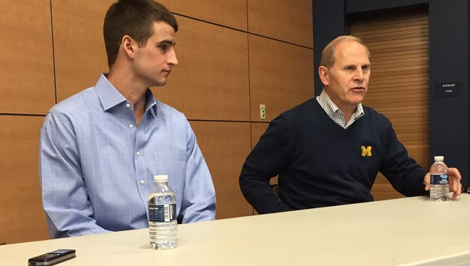 Michigan basketball coach John Beilein, right, and former player Austin Hatch speak to the media Monday, April 27, 2015.