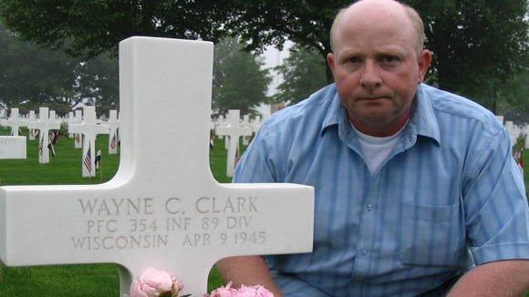 Jo Winkens has been caring for Wayne Clark's grave for about a decade.