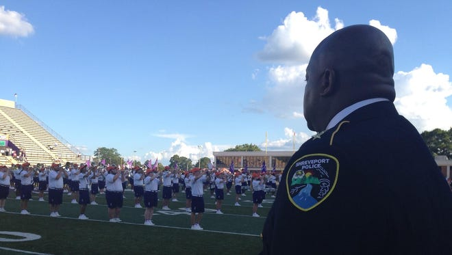 Shreveport Police Chief Willie Shaw waits to lead officers onto the field at Turpin Stadium Thursday. A memorial scholarship at Northwestern State University in the name of slain officer Thomas LaValley was announced before the first football game of the season. LaValley was a 2007 graduate of NSU.