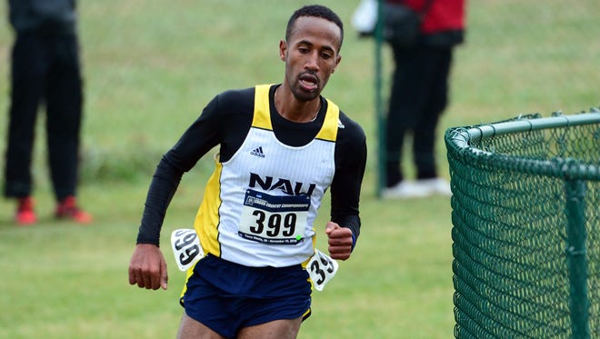 Former North Central standout Futsum Zienasellassie finished fourth in Saturday's NCAA Cross-Country Championships, helping Northern Arizona to the team title.