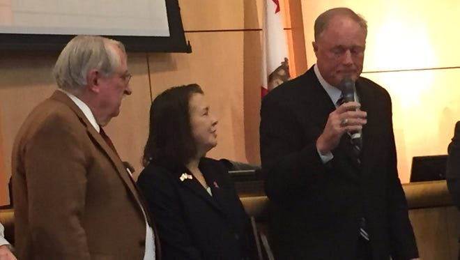 Supervisors Pam Giacomini, center, and Bill Schappell are honored at their last board meeting as county supervisors.