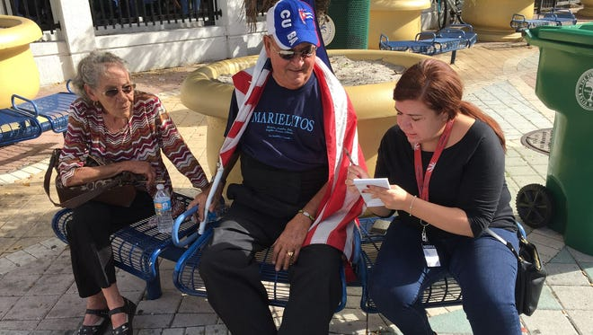 On assignment: Melissa Montoya interviews a man during an anti-Fidel Castro rally in Miami shortly after the leader died in November.
