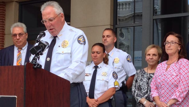 York County Sheriff Richard Keuerleber announces the dates of Operation Safe Surrender at a news conference at the York County Judicial Center on Wednesday, June 21, 2017. At far left is chief public defender Bruce Blocher. (Liz Evans Scolforo photo)