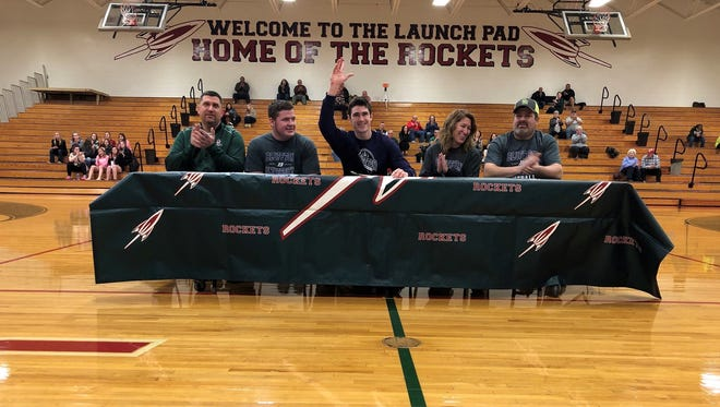 Oak Harbor's Tate Smith continues his football career at Bluffton University. He's joined at his announcement by Rockets coach Mike May, Parker Smith, Lesa Smith and Patrick Smith.