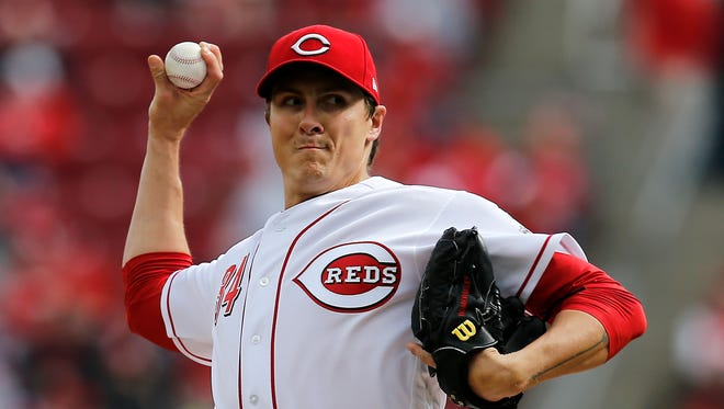Cincinnati Reds starting pitcher Homer Bailey (34) delivers a pitch in the first inning of the MLB Opening Day game between the Cincinnati Reds and the Washington Nationals at Great American Ball Park in downtown Cincinnati on Friday, March 30, 2018.