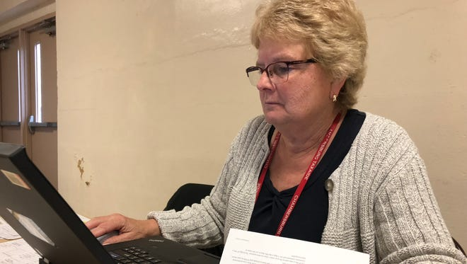 Deborah Hallock, a tax preparer for AARP's TaxAide program, works on taxes the morning of Monday, April 16 at the recreation center in Chambersburg. All taxes need to be completed and filed by Tuesday, April 17.